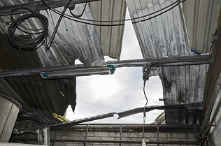 Photo shows the damaged roof where the explosion took place