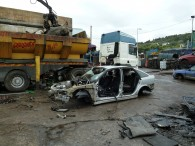 Photo shows the car which fell on a young mechanic at North End Salvage Services in Stalybridge