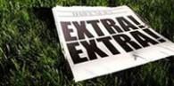 Newspager on grass