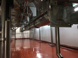 Screw conveyor at AMC Freshly Squeezed