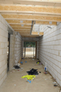 Temporary stairwell cover gave way injuring three bricklayers